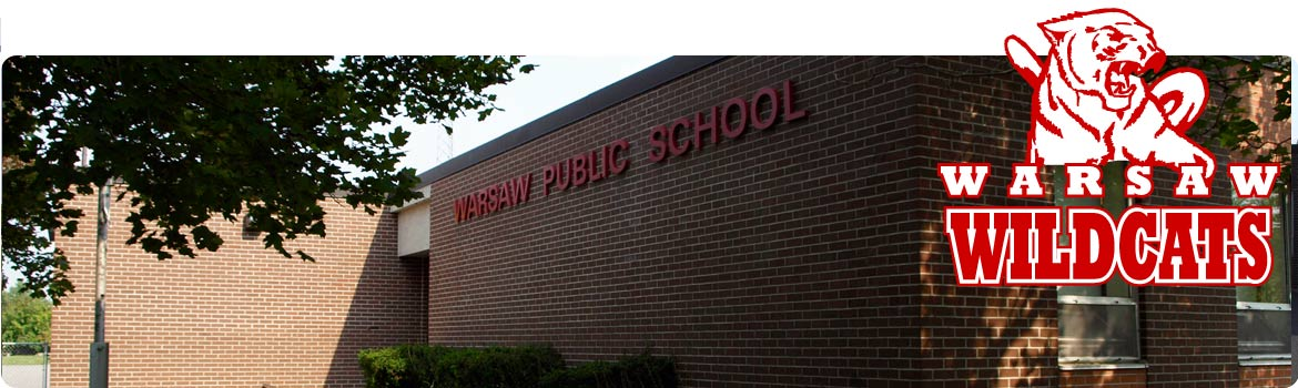 This is a picture of the front of our school with the name in red letters.